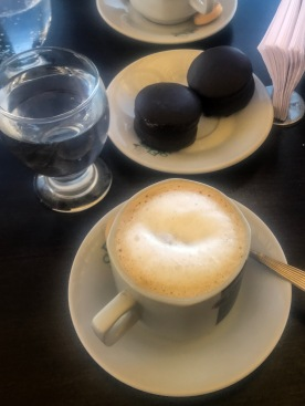 Cafe con leche and chocolate covered alfajores